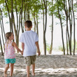 Brother and sister at beach — Stock Photo #18803527