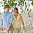 Stock Photo: Couple holding hands at beach