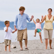 Family playing at beach — Stock Photo