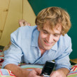 Stock Photo: Min tent text messaging on cell phone
