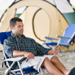 Stock Photo: Musing mp3 player at campsite