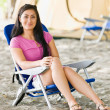Stock Photo: Womsitting in chair at campsite