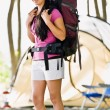 Stock Photo: Womcarrying backpack at campsite