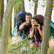 Couple with backpacks and binoculars outdoors — Stock fotografie #18803723