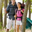 Couple in backpacks hiking — Stock Photo