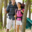 Stock Photo: Couple in backpacks hiking