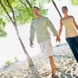 Couple walking holding hands at beach — Stock Photo