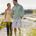 Couple walking on beach — Stock Photo #18803829