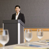 Woman Smiling Behind Podium — Stock Photo