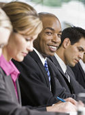 Businessman at Meeting Smiling — Stock Photo