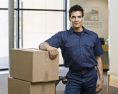 Young Man Standing With Boxes — Stock Photo