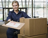 Young Woman Moving Boxes — Stock Photo