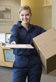 Young Woman Delivering Box — Stock Photo