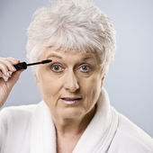 Older Woman Putting on Makeup — Stock Photo