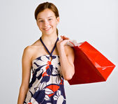 Teenage girl holding shopping bag — Stock Photo