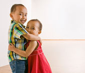 Brother and sister hugging — Foto de Stock