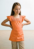 Skeptical girl with hands on hips — Stock Photo