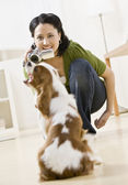 Woman Video Taping Dog — Stock Photo