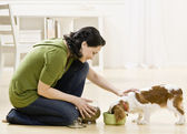 Woman Feeding Puppy — Fotografia Stock