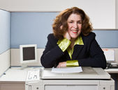 Businesswoman copying papers in office — Stock Photo