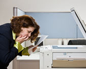 Businesswoman having trouble with copy machine — Stock Photo