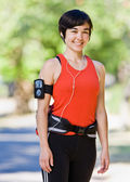 Woman wearing hip pack and mp3 player — Stock Photo