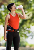 Runner drinking from water bottle — Stock Photo