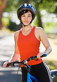 Woman on bike smiling — Stock Photo