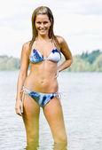Woman wading in lake water — Stock Photo