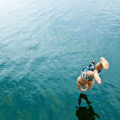 Man diving into lake — Stock Photo