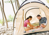 Couple playing boardgame in tent — Stock Photo