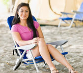 Woman sitting in chair at campsite — Stock Photo