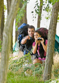 Couple with backpacks and binoculars outdoors — Stock Photo