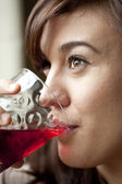 Young Woman Drinking Cranberry Juice — Stock Photo