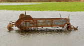 Flooded Antique Farming Equipment — Stock Photo