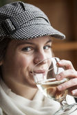 Young Woman Drinking White Wine — Stock Photo