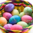 A Dozen Easter Eggs in an Easter Basket — Stock Photo
