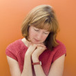Stock Photo of a Woman on Orange Background - Foto Stock