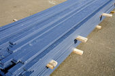 Pile of blue boards at a construction site. — Stock Photo