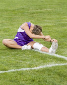 Stock Photo of a Cross Country Runner Stretching — Stock Photo