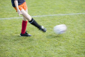 Girls Soccer Player Passing the Ball — Photo