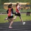 Stock Photo: Two Sprinters Crossing the Finish Line