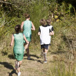 Cross Country Runners on a Wooded Trail — Stock Photo