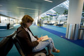 Woman Reading at an Empty Airport Lounge — Stock Photo