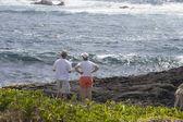 Couple Surveys the Ocean, Kau District, Big Island, Hawaii — Stock Photo