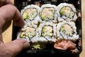 Taking One Tuna Sushi Roll — Stockfoto