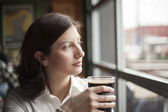 Young Woman with Beautiful Brown Eyes Drinking a Pint of Stout — Foto de Stock