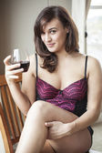 Young Woman in Lingerie Drinking Red Wine — Stock Photo