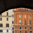 Royalty-Free Stock Photo: Buildings in Rome Framed by Colosseum Arch