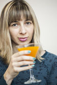 Young Woman Drinking Mango Juice — Stock Photo